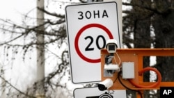 FILE - CCTV cameras are installed over a road in Moscow, Russia.