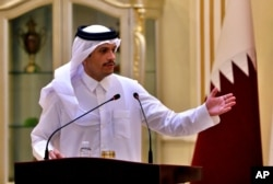 FILE - Qatar's foreign minister, Sheikh Mohammed bin Abdulrahman al-Thani, speaks during a press conference in Baghdad, Iraq, March. 24, 2021.