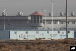 FILE.- A guard tower and barbed wire fences are seen around a facility in the Kunshan Industrial Park in Artux in western China's Xinjiang region, Dec. 3, 2018. This is one of a growing number of internment camps in Xinjiang.