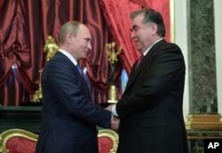 FILE - Russian President Vladimir Putin shakes hands with his Tajikistan's counterpart Emomali Rakhmon, right, at the Kremlin, Moscow.