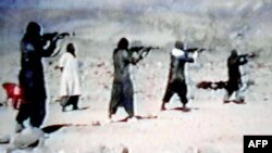 An image from a video dated June 19, 2001, shows members of Al-Qaeda training at their al-Farouq camp in Afghanistan.