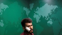 A portrait of Neamat Naghdi, 28 year-old-video reporter for Etilaat Roz newspaper who was beaten by the Taliban during incarceration, at the newspaper office in Kabul, Afghanistan, Sept. 9, 2021.