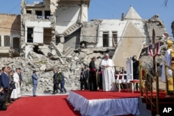 FILE - Pope Francis arrives to pray for the victims of war at Hosh al-Bieaa Church Square in Mosul, Iraq.