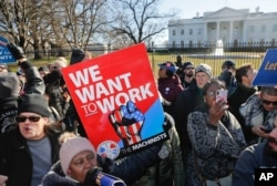 FILE - Union members and other federal employees stop in front of the White House in Washington during a rally to call for an end to the partial government shutdown, Jan. 10, 2019.
