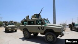 FILE - African Union Mission in Somalia (AMISOM) peacekeepers travel in an armored vehicle in Mogadishu, Somalia. Feb. 28, 2019.