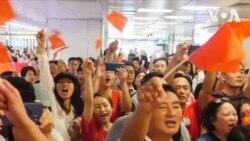 Des manifestants pro-Pékin et anti-gouvernementaux s'opposent à Hong-Kong