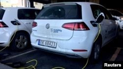FILE - Electric cars are being recharged in Oslo, Norway, Jan. 2, 2019.