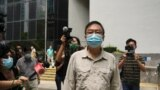 Pro-democracy activist Cheung Man-kwong walks out of a court after receiving a suspended sentence in Hong Kong, Wednesday, Sept. 15, 2021. Nine Hong Kong activists and ex-lawmakers were handed jail sentences of up to 10 months, and three others…