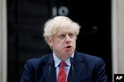 British Prime Minister Boris Johnson makes a statement on his first day back at work in Downing Street, London, after recovering from a bout with the coronavirus that put him in intensive care, Monday, April 27, 2020. The highly contagious COVID-19…