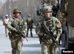 British soldiers with the NATO-led Resolute Support Mission arrive at the site of an attack in Kabul, Afghanistan, March 6, 2020.