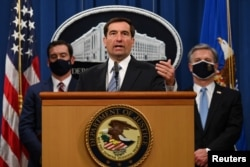 FILE - John Demers of the National Security Division speaks during a press conference at the Justice Department in Washington, Oct. 7, 2020.