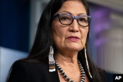 FILE - In this April 23, 2021, file photo, Interior Secretary Deb Haaland speaks during a news briefing at the White House in Washington. Haaland approved a new constitution for the Cherokee Nation on Wednesday, May 12, 2021 that ensures citizenship…