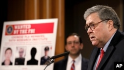 Attorney General William Barr announces that members of the Chinese military have been charged with hacking the computer networks of U.S. credit rating giant Equifax, Feb. 10, 2020, at the Justice Department in Washington.