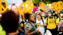 FILE - Black Lives Matter organizer Teal Lindseth, 21, leads protesters in Portland, Ore.