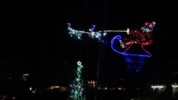 Parade of Boats Glitter With Festive Holiday Lights