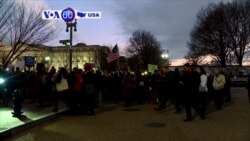VOA60 America - US restricts immigration from several Middle Eastern and African countries
