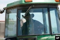 Farmer John Boyd Jr., runs his hay bailer at his farm in Boydton, Va., May 27, 2021.