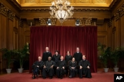 FILE - The justices of the U.S. Supreme Court gather for a formal portrait Nov. 30, 2018. Alabama's virtual ban on abortion is the latest state law seemingly designed to prod the Supreme Court to reconsider Roe v. Wade.