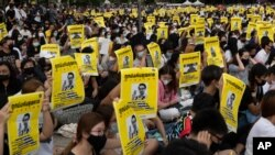 Pro-democracy students hold posters of a missing Thai activist during a protest at the Thammasat University in Pathum Thani, north of Bangkok, Thailand, Aug, 10, 2020.