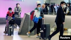 Passengers arrive at LAX from Shanghai, China, after a positive case of the coronavirus was announced in the Orange County suburb of Los Angeles, California, U.S., January 26, 2020.
