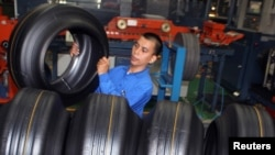 FILE - A worker removes a tire during a production in a Goodyear factory in Bogor of the Indonesia's West Java Province, Apr. 29, 2010.