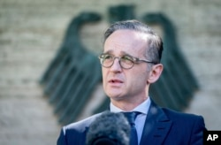 FILE - German Foreign Minister Heiko Maas addresses the media during a statement at the foreign ministry in Berlin, Germany, June 3, 2020.