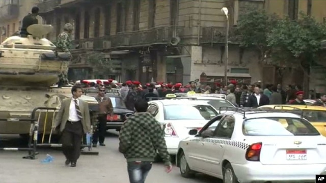 Police march through downtown Cairo, demanding better pay and respect, 14 February 2011