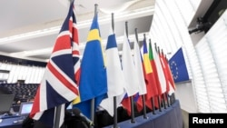 FILE - The British flag and others flags from EU countries are pictured at the European Parliament in Strasbourg, eastern France, Dec.13, 2017.