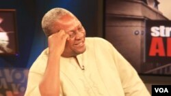 Ghana's Vice President John Dramani Mahama shares a laugh during the interview