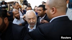 Rached Ghannouchi (C), leader of Ennahda Party, speaks to the media after a meeting, as part of a dialogue between ruling Islamists and the opposition, which aims to pave the way for the formation of a transitional government, in Tunis, Nov. 2, 2013.