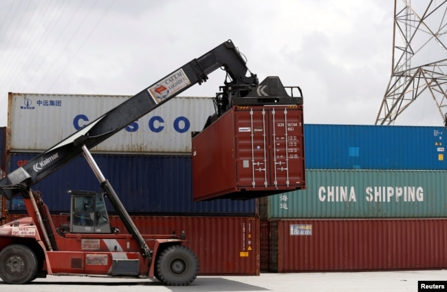 Containers of China Shipping and Cosco are loaded at a port in Ho Chi Minh City, Vietnam, July 27, 2018.