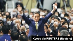 Yoshihide Suga gestures as he is elected as new head of the ruling party at the Liberal Democratic Party's (LDP) leadership election paving the way for him to replace Prime Minister Shinzo Abe, in Tokyo, Japan September 14, 2020. (Kyodo via REUTERS)