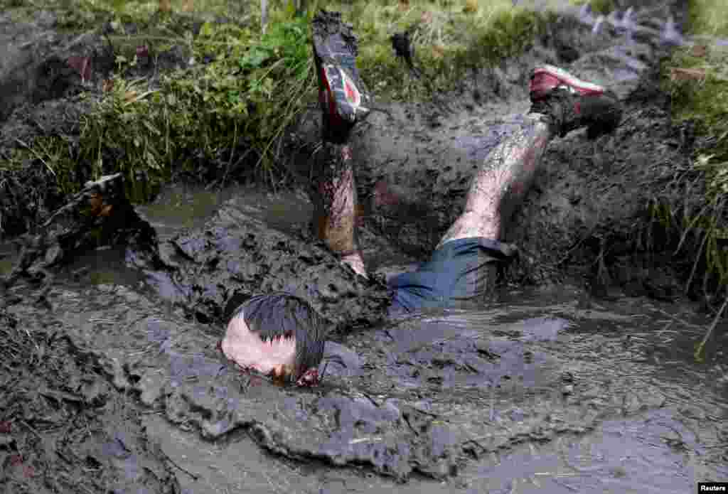 A man takes part in an extreme run competition in Zhodino, east of Minsk, Belarus, Sept. 26, 2015.