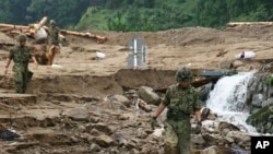 Japan Ground Self-Defense Force soldiers run a rescue operation in Kiho town, Mie Prefecture, September 5, 2011.