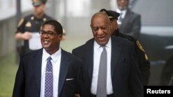 Actor and comedian Bill Cosby, right, arrives with his publicist, Andrew Wyatt, for jury selection for his sexual assault trial at the Montgomery County Courthouse in Norristown, Pennsylvania, April 4, 2018.