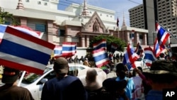 In October 2009, Thai activists wave Thai flags and chant slogans during a rally against Prime Minister Hun Sen's decision to make ousted Prime Minister Thaksin Shinawatra his economic adviser, and the recent protest may just worsen the already tense rela