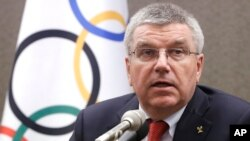 FILE - Thomas Bach and the IOC declined to ban the Russian Olympic team from the Rio Games.