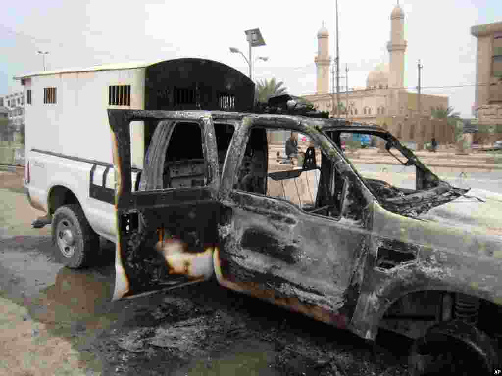 A burned police vehicle left in the main street of Fallujah after clashes between Iraqi security forces and al-Qaida fighters, Jan. 5, 2014