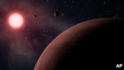This artist rendering provided by NASA/JPL-Caltech shows some of the 219 new planet candidates, 10 of which are near-Earth size and in the habitable zone of their star identified by NASA's Kepler space telescope. (NASA/JPL-Caltech)