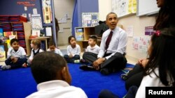 United States President Barack Obama sits with 3- and 4-year-old students in a pre-kindergarten class at Powell Elementary School in Washington, DC, March 2014.