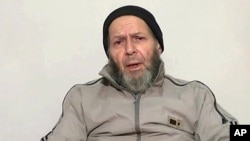 An image made from video released anonymously to reporters in Pakistan on Dec. 26, 2013 shows 72-year-old American development worker Warren Weinstein, who was kidnapped by al-Qaida, appealing to President Obama to negotiate his release.