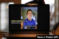 In this April 26, 2020, file photo, University of Pittsburgh graduate Dallas Mavericks owner Mark Cuban congratulates members of the Class of 2020 during a virtual commencement on a computer screen in Pittsburgh.