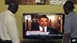 Kenyans watch U.S. President Barack Obama on television in Nairobi, Kenya announcing the death of Osama bin Laden in Pakistan, Monday, May 2, 2011