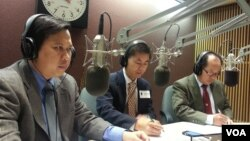 """Tung Yap, center, a civil engineer and head of Cambodian Americans for Human Rights and Democracy and Schanly Kuch, right, works at the Education Department in Maryland on """"Hello VOA"""" Thursday."""