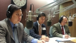 "Tung Yap, center, a civil engineer and head of Cambodian Americans for Human Rights and Democracy and Schanly Kuch, right, works at the Education Department in Maryland on ""Hello VOA"" Thursday."