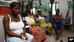 Pregnant women watch television as they wait in the pre-natal ward at Princess Christian Maternity Hospital in Freetown, Sierra Leone, September 10, 2010.