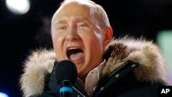 Shugaban Rasha Vladimir Putin yayinda yake murnar sake lashe zaben shugaban kasa