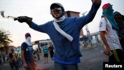 Người biểu tình chống chính phủ ở San Cristobal, Venezuela, 27/2/14