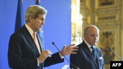 French Foreign Affairs Minister Laurent Fabius, right, U.S. Secretary of State John Kerry at joint press conference, Paris, March 7, 2015.