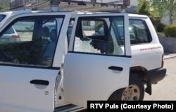 Oštećeni automobil RTV Puls